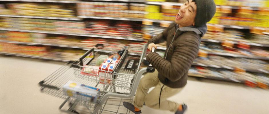 Shot of Karon shops for grocerys at a supermarket